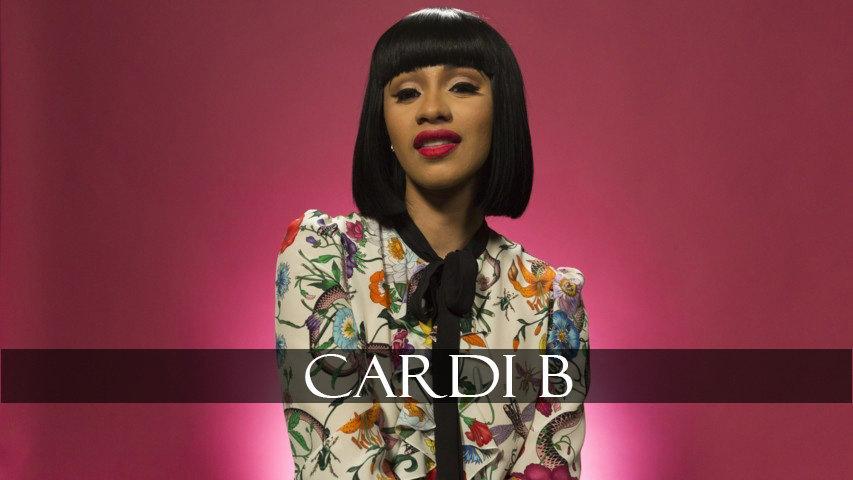 Cardi B in dark pink background