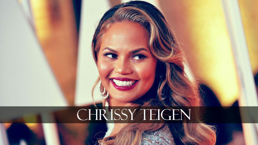 Chrissy Teigen smiles beautifully
