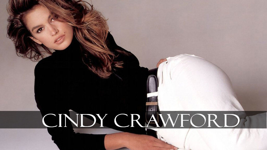 Cindy Crawford wears white pant and black top