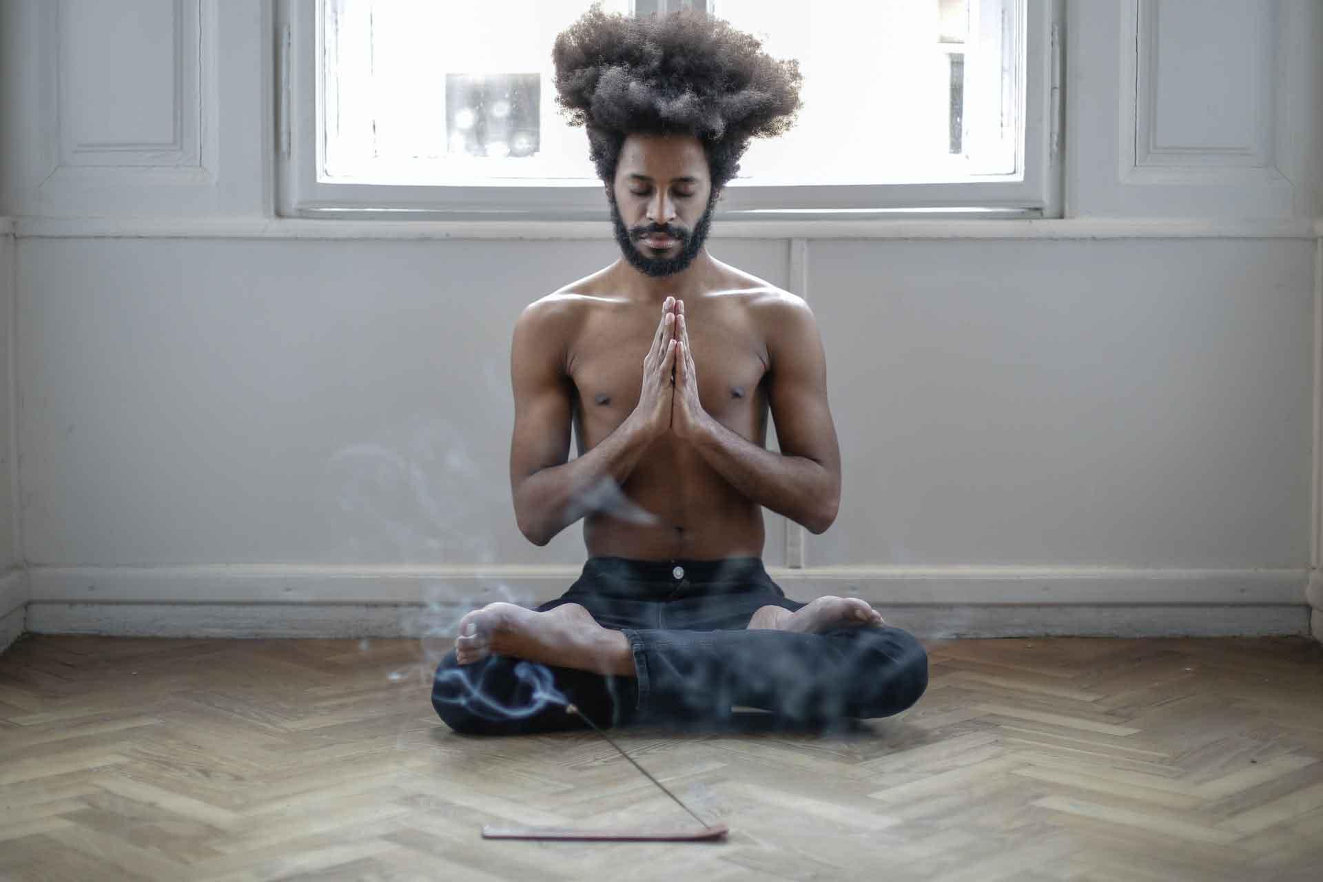 black man in yoga form